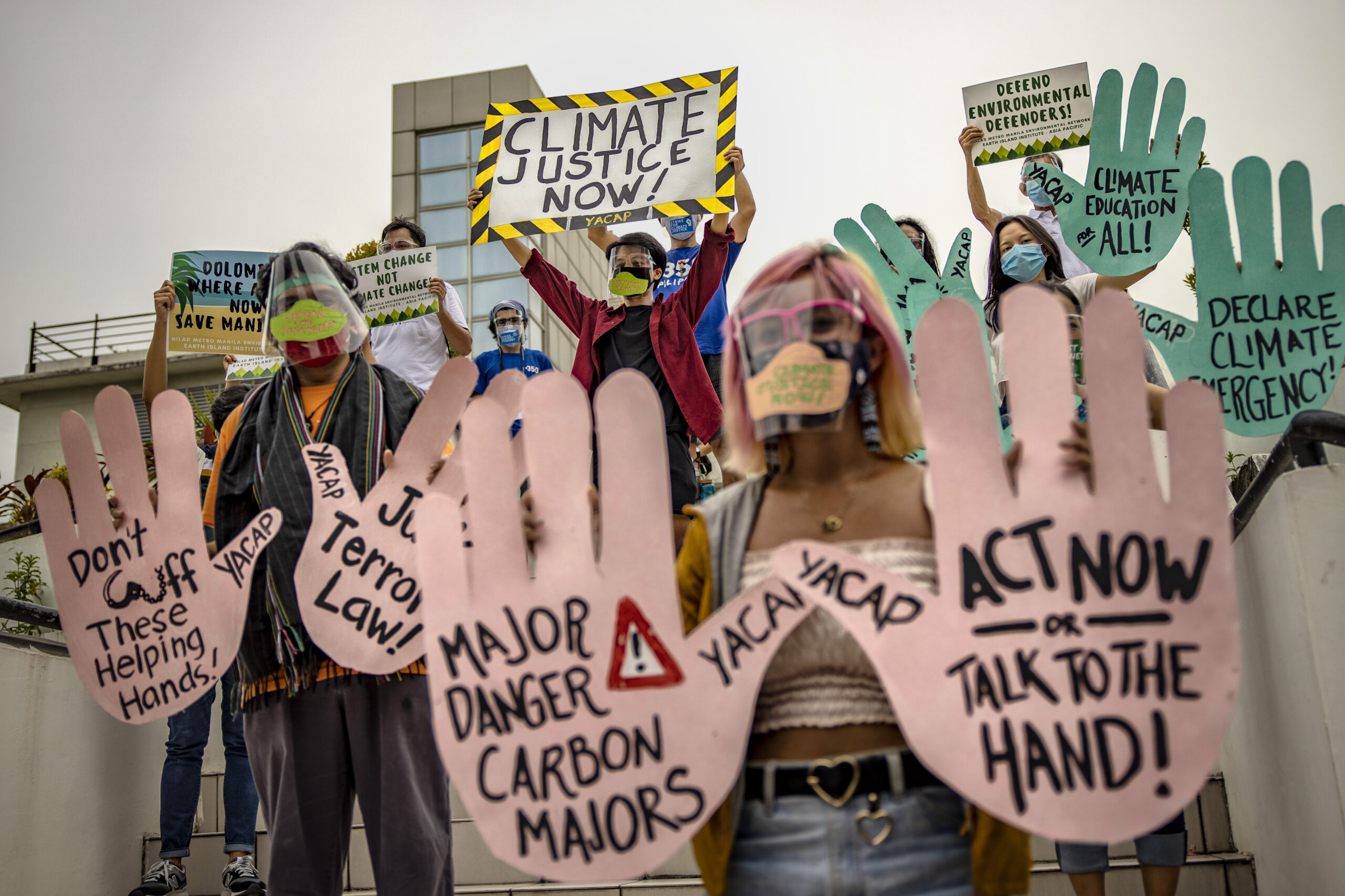 MANILA, PHILIPPINES - SEPTEMBER 25: Environmental activists, wearing facemasks and face shields to protect against COVID-19, take part in a rally coinciding with global protests on the climate crisis on September 25, 2020 in Manila, Philippines. The Global Climate Strike, also known as the Fridays for Future movement, is observed to demand urgent action from governments around the world to address the climate crisis. (Photo by Ezra Acayan/Getty Images)